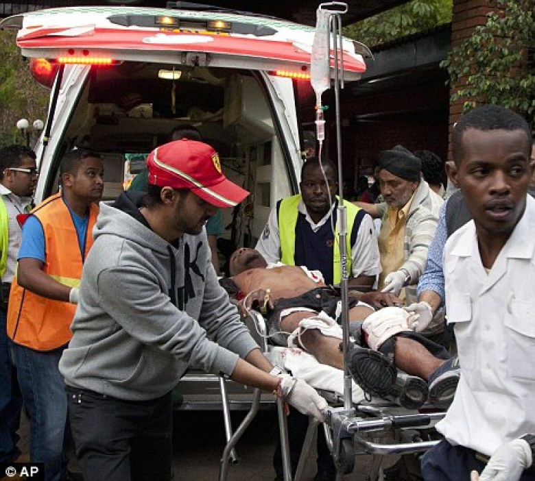 An injured person arrives in an ambulance at the Aga Khan Hospital following an attack at the Westgate Mall after gunmen opened fire and threw grenades in Kenya