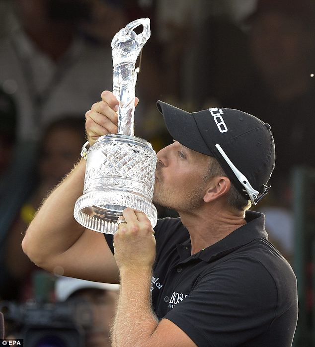 Comeback king: Henrik Stenson kisses the Tour Championship trophy
