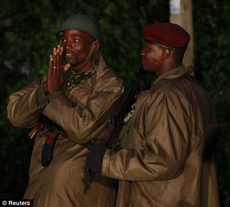 Patience: Members of Kenya's security forces man a checkpoint outside the Westgate Mall in Nairobi, Kenya early Monday, Sept. 23, 2013