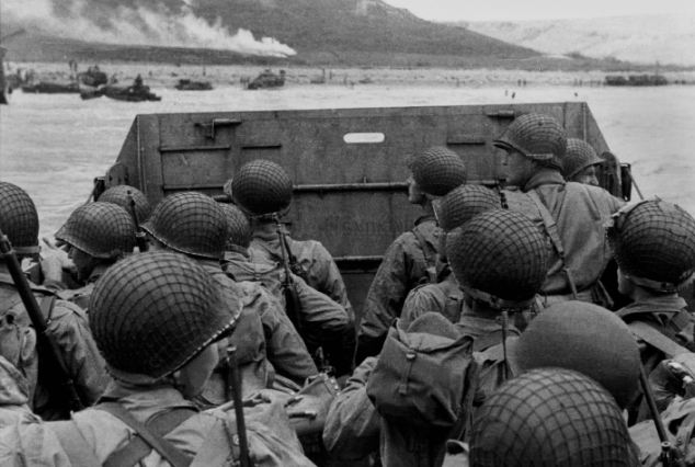 American assault troops move onto a beach in Normandy France, on D-Day during Operation Overlord 1944