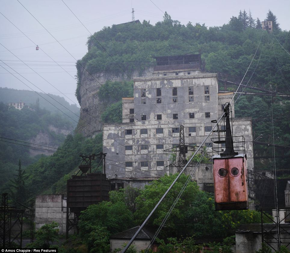 Commute: Soviet era miners took the aerial tramway to work at the manganese processing plants dotted across the hills surrounding Chiatura