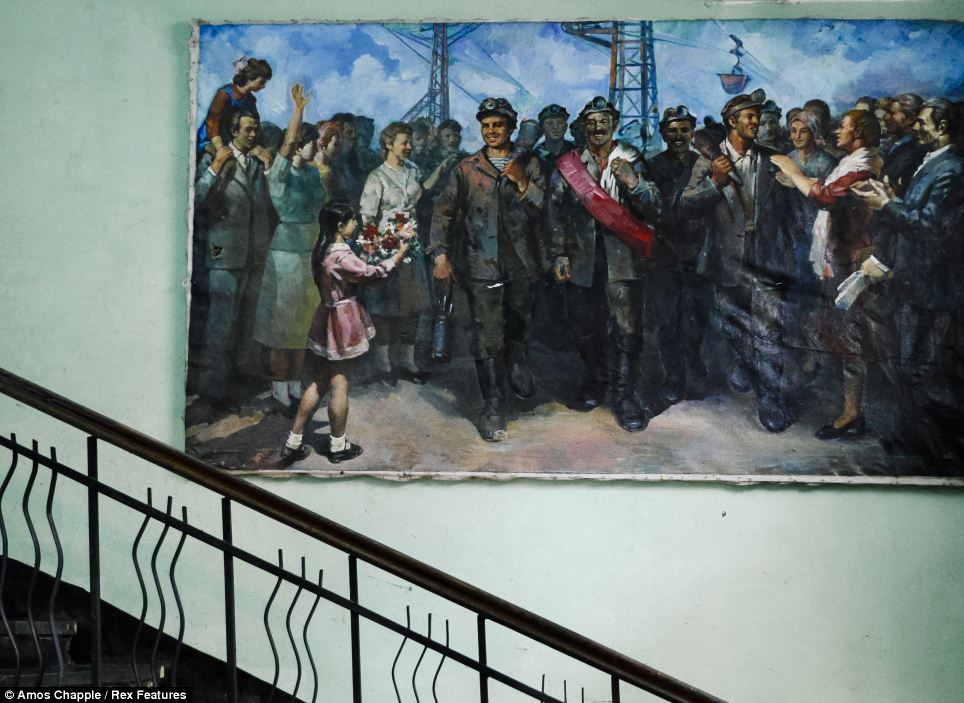 Art: A Socialist realist painting hanging on the inside of a building in Chiatura celebrates the manganese miners of the town