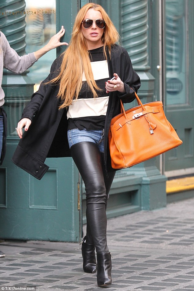 I'd rather go shopping! Lindsay Lohan, seen here shopping in New York on Wednesday, has been criticised by the director of The Canyons for persistently failing to support the film