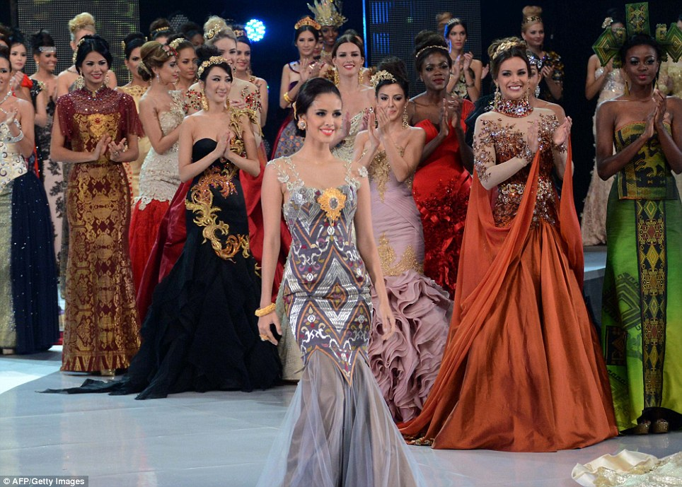 Protests: Miss Philippines Megan Young (C) on the catwalk. Extremists are threatening to attack the pageant's final which they have dubbed 'pornography'