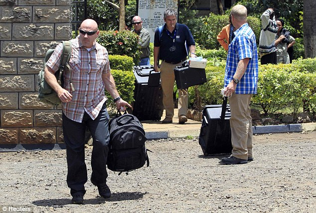 Gathering evidence: Foreign forensic experts arrive to collect data as investigations continue into the attacks