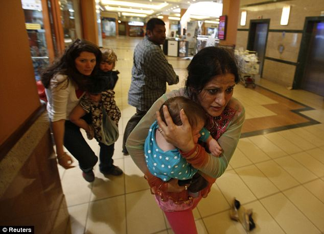 Terrifying: Katherine Walton, left, is an American living in Kenya who was at the Westgate mall last Saturday with her five kids when the siege occurred. They got out alive with the help of Haji