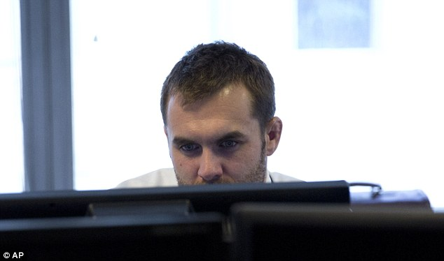 Paul Hyland, a Met super recogniser, scans CCTV footage in this photo taken in September 2013