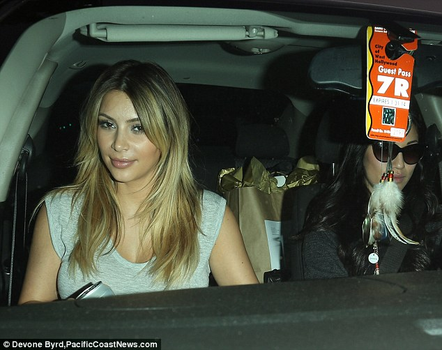Happy: Kim appeared to be in a friendly mood as she drove away with her food and back to the Beverly Hills Hotel