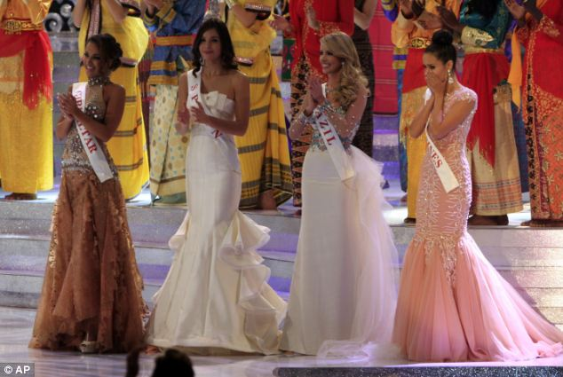 Stunned: The brunette beauty gasped and held her hands to her mouth as she was named Miss World 2013