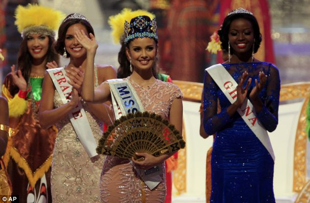 Sparkling: Ms Young, who took the crown from last year's winner Wenxia Yu of China, was born in the United States
