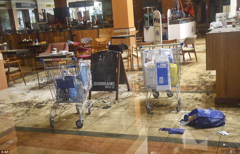 Dormans coffee shop on the ground floor of the mall: Abandoned trolleys, dropped shopping bags and coffee cups left on the tables show the chaos as people fled for their lives before the gunfire