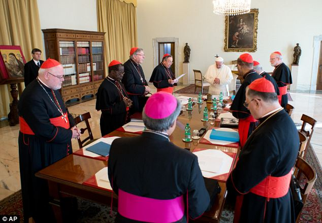 'Wise people': Pope Francis poses meets with his so-called 'Group of Eight' cardinals, during their first of three days of meetings at the Vatican today to help him reform Vatican administration, known as the Curia