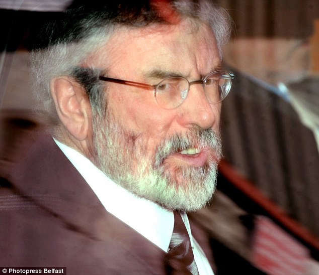 Brother: Gerry Adams is driven from Belfast Crown Court in April 2013 after spending the day giving evidence in the first trial of his brother Liam, which collapsed. He was not called to appear at the latest one