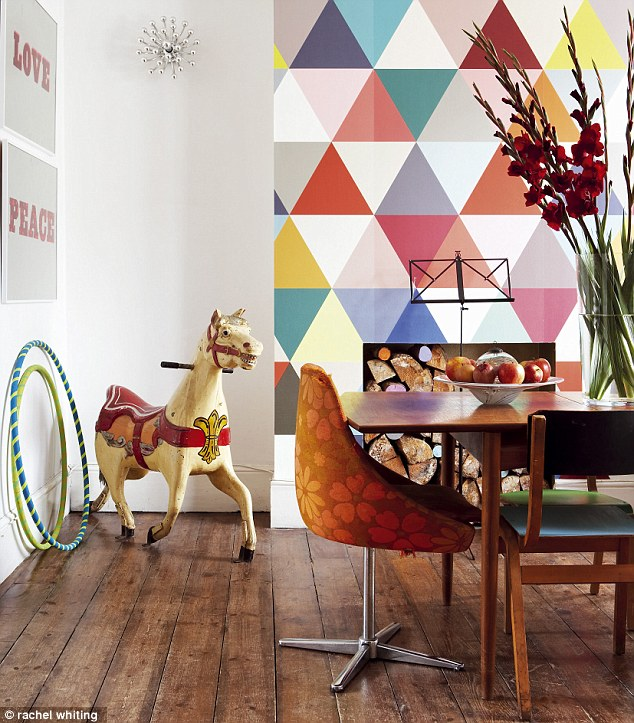 Here, a super-sized geometric wallpaper used on one wall brings a playful feel to a dining room