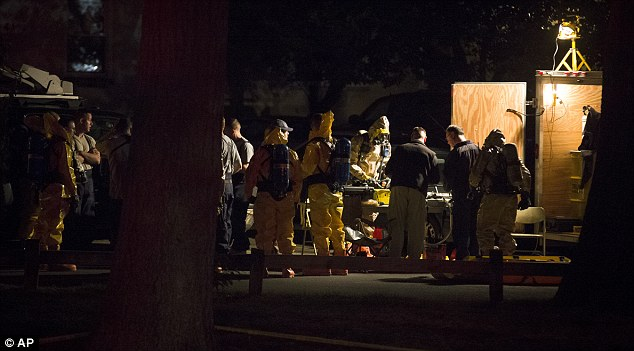 Stamford: Hazardous materials personal prepare to enter the apartment complex where Miriam Carey is believed to have lived in the early hours of this morning after a neighbor said the dental hygienist 'absolutely' was crazy