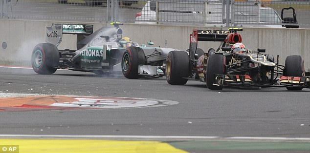 Trying his hardest to get past: Lewis Hamilton fighting with Grosjean near the start