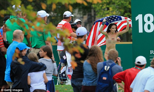 Star Spangled Banner: The streaker runs on the 18th hole during the Day Four Singles Matches at the Muirfield Village Golf Club in Dublin, Ohio today