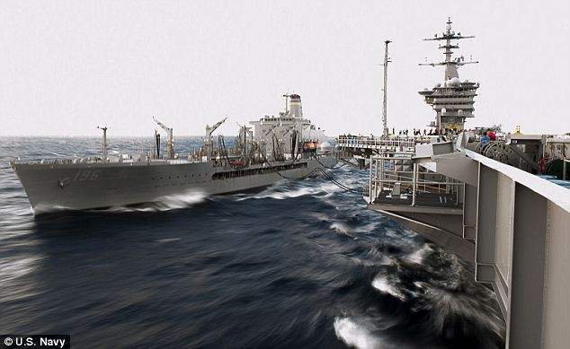Mammoth task: The aircraft carrier USS Theodore Roosevelt (right) pulls alongside the replenishment oiler USNS Kanawha (left) during a first underway replenishment in four years