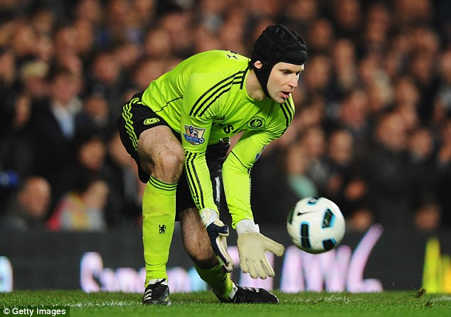 Too much protection? Parents are questioning whether high school soccer is dangerous enough to require the use of helmet. (Pictured, Chelsea goalkeeper Goalkeeper Petr Cech)