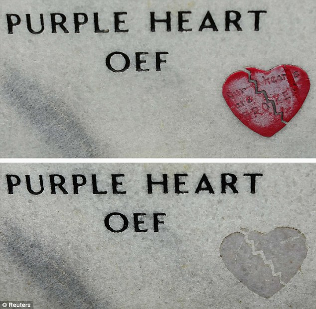 Unhealed: A broken heart (top) which has later been stripped from the gravestone of a soldier killed in Afghanistan. A shadow of the momento remains