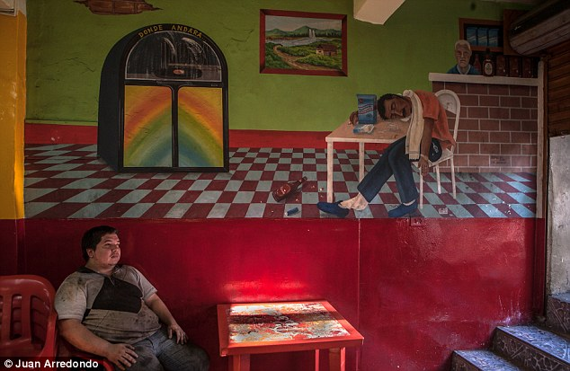 Pit stop: A worker rests in a local bar in Barrio Triste