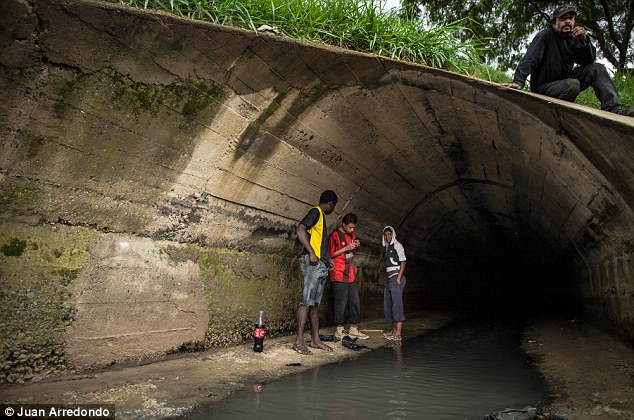 Deprived: Homeless teenagers gather in a sewage tunnel that runs under the neighborhood