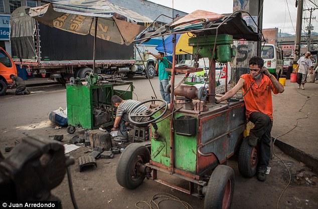 Grime: Workers repair vending carts on the street