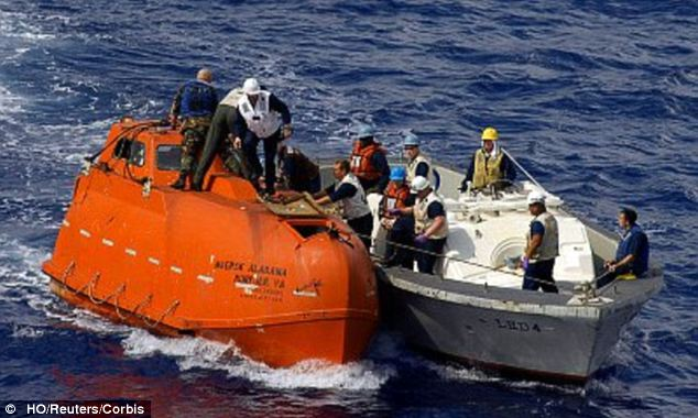 Drama: The film dramatizes the April 2009 attack on the Maersk Alabama, which ended with a SEAL Team 6 amphibous rescue of Phillips, who was tied up but unhurt with the pirates in the ship's tiny life boat (pictured)