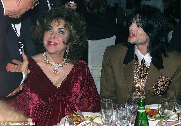 Surrogate mother: Jackson made Taylor (seen here together in 2000) the godmother of his two eldest children