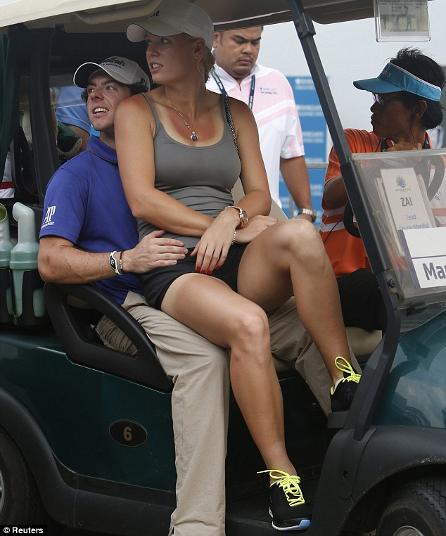 MciIroy and Wozniacki, pictured sharing a buggy at the Singapore open in 2012, have split despite sending out wedding invitations over the weekend