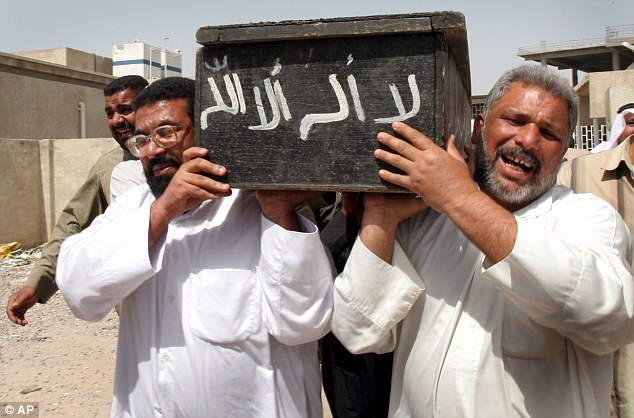13 year-old-boy's coffin is carried by relatives in Basra
