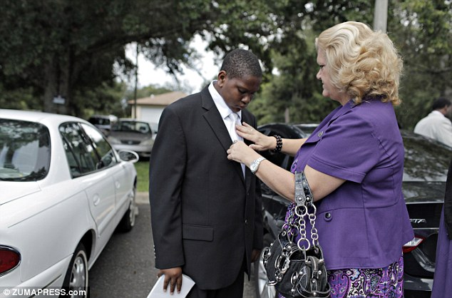 Davion Only, 15, gets some last-minute help with his tie from his case worker Connie Going before nervously making his speech before the congregation