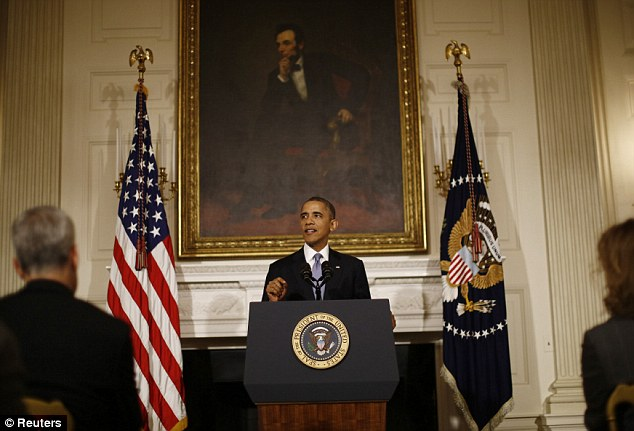 Stern: U.S. President Barack Obama delivers remarks on the end of the U.S. government shutdown in the State Dining Room of the White House in Washington, October 17, 2013