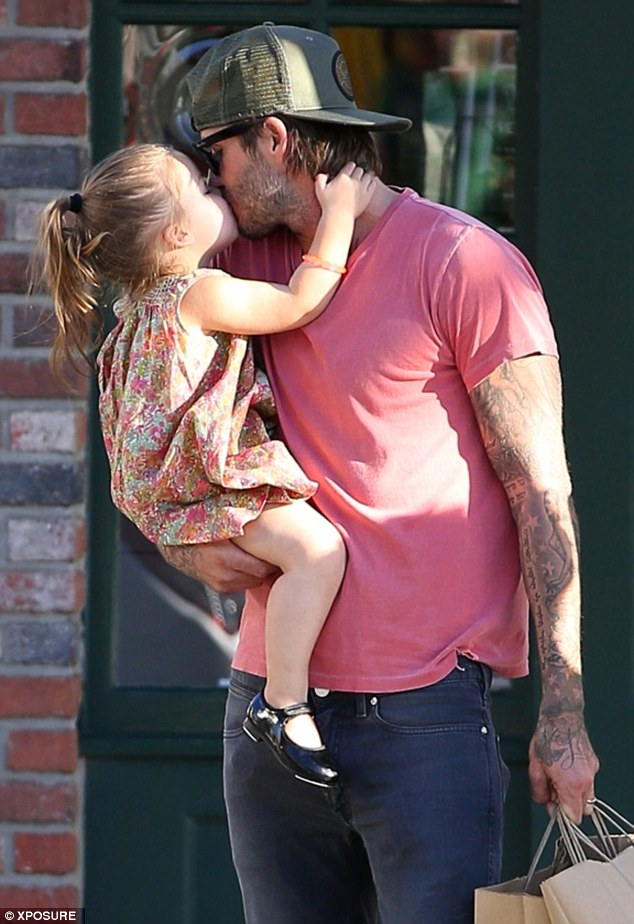 Right back at ya: Harper was more than happy to give her daddy plenty of kisses in return