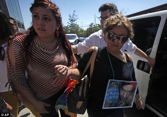 Jacqueline Vera (right) wearing a photograph of her son Daniel, wept as the guilty verdicts were read out
