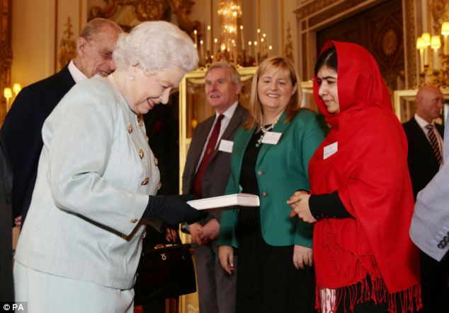 Present: Malala Yousafza presents a copy of her book to the Queen during a reception at Buckingham Palace