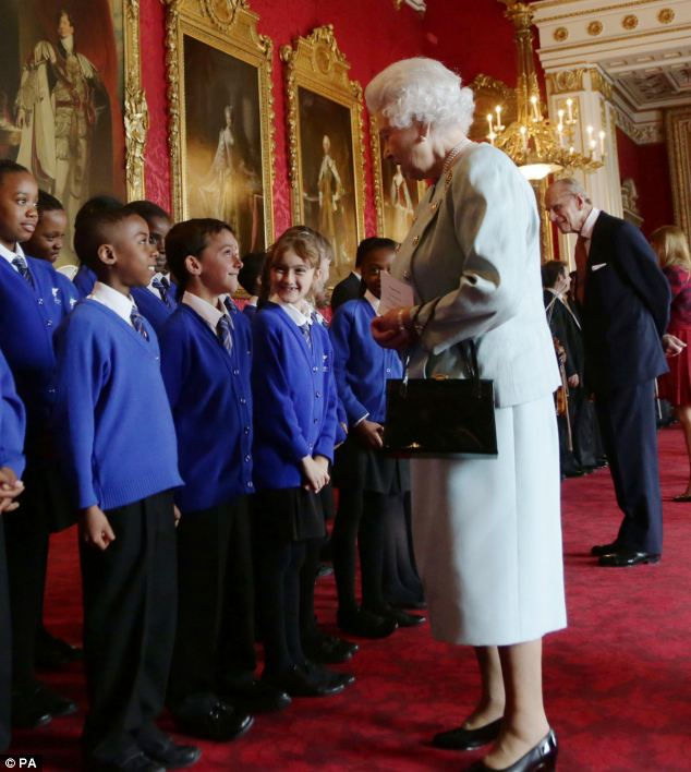 Performance: Children from the choir of St Winefride's School also sung for the guests at the event