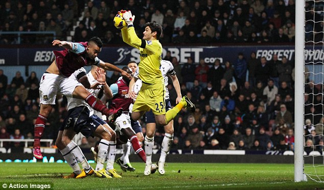 In control: Lloris catches the ball under pressure in his area