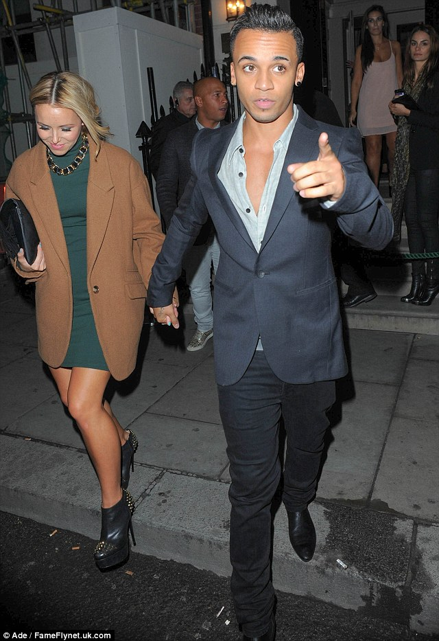 Alright Simon! Aston wears his shirt with more than a few buttons down while holding girlfriend Sarah Richards hand
