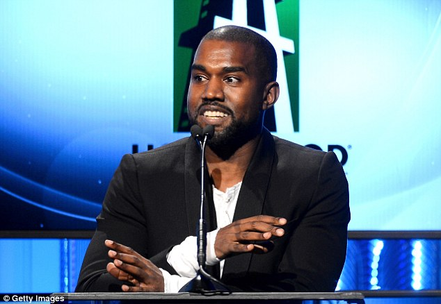 Dashing: Kanye looked dapper in a black suit and white shirt as he entertained the crowd