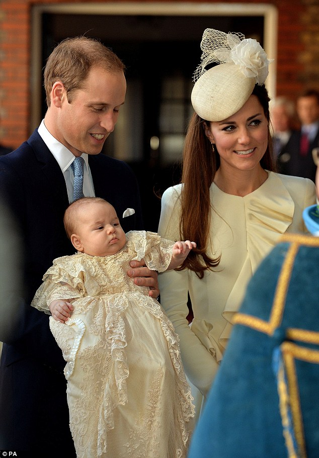 Momentous occasion: The Duke and Duchess of Cambridge with their son Prince George arrive at Chapel Royal in St James's Palace where they are welcomed by the Archbishop of Canterbury