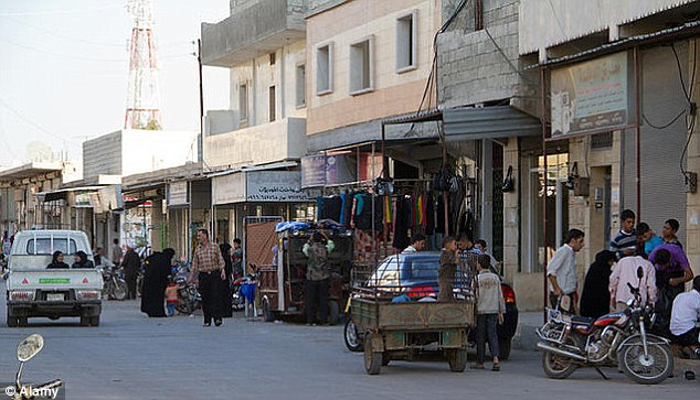 Street scene: The town of Azaz near the Turkish border which has been taken over by al-Qaeda as part of an attempt to turn Syria into an Islamic state