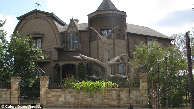 Spooky: The outside of Charles and Sandra's house in Texas which has been made to look like the home of The Munsters