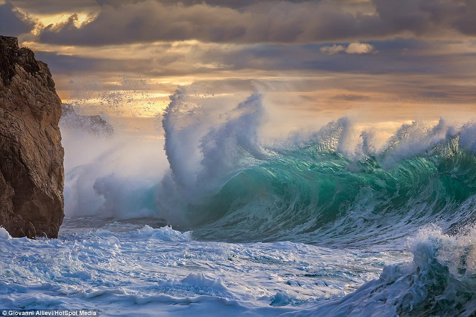 Image result for waves crashing on sea cliff
