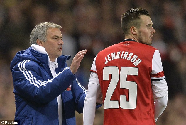 Warm welcome: Mourinho gives Arsenal defender Carl Jenkinson a pat on the back during the game