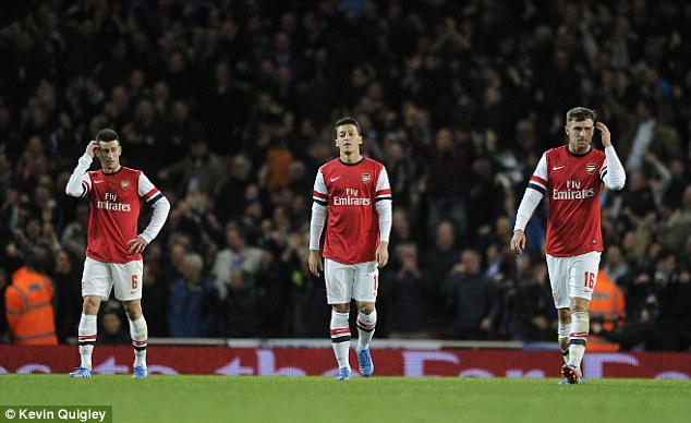 No cigar: Mesut Ozil (centre), Aaron Ramsey (right) and Laurent Koscielny look dejected after going two down