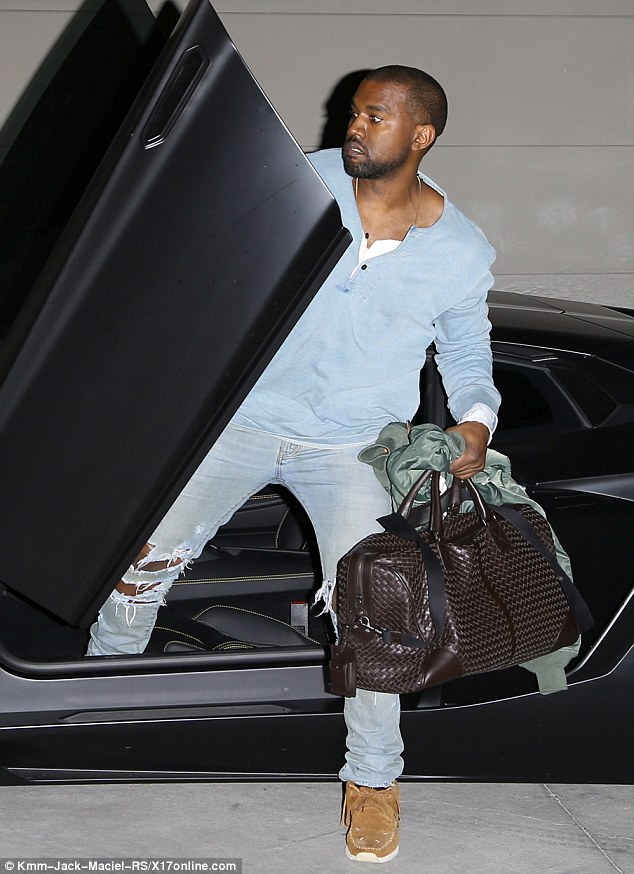 Suave: The Yeezus rapper wore what seems to be a favourite light blue sweater as he slipped out