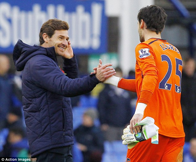 All smiles: Andre Villas-Boas says he went against medical advice to keep Hugo Lloris on the pitch after concussion