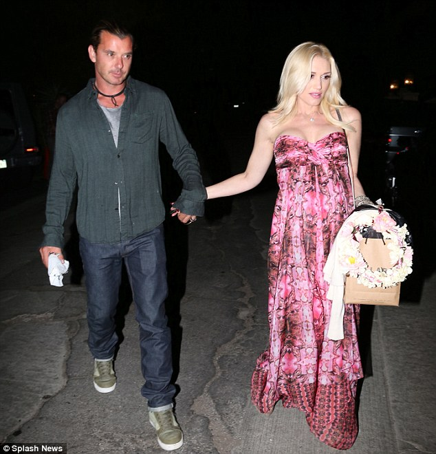 Date day out: Gwen was later seen leaving the shower alongside husband Gavin Rossdale