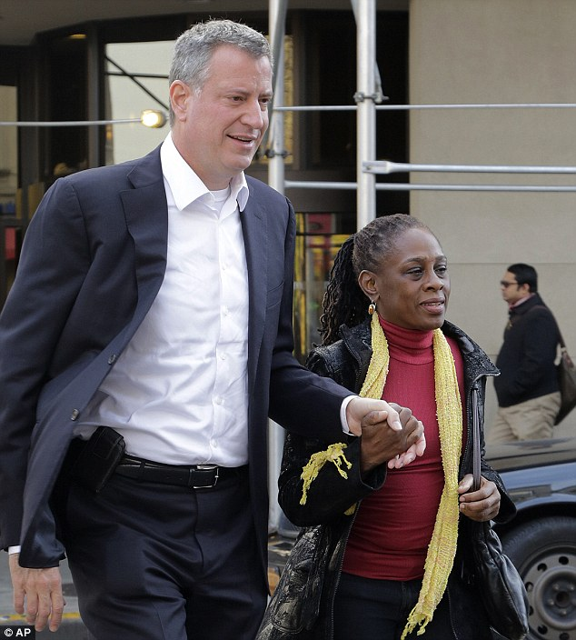 Partners: Bill De Blasio's marriage to Cirlane McCray, a former lesbian, was a major development in De Blasio's ride to power. The couple are seen today after their landslide victory